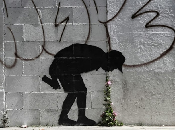 banksy-graffiti-throwing-up-flowers.jpg.662x0_q100_crop-scale