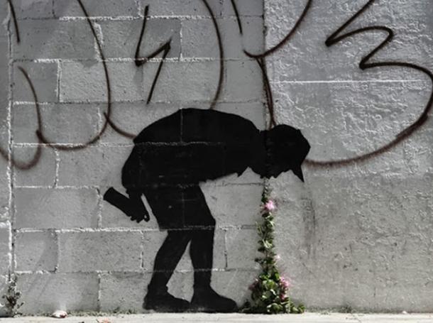 banksy-graffiti-throwing-up-flowers.jpg.662x0_q100_crop-scale